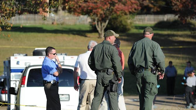 Deputies respond to a call at the home just over the state line in Fayetteville, Tenn., Monday, Oct. 22, 2012. Police say the deaths of three young women and a toddler in two separate homes in Lincoln County could be related and they are searching for a man they believe to be armed and dangerous. (AP Photo/The Huntsville Times, Sarah Cole)