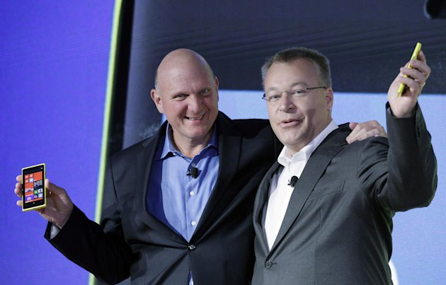Steve Ballmer, left, Chairman and CEO of Microsoft, and Stephen Elop, President and CEO of Nokia, introduce Nokia&#39;s newest smartphone, the Lumia 920, equipped with Microsoft&#39;s Windows Phone 8, Wednesday, Sept. 5, 2012 in New York. Nokia revealed its first smartphones to run the next version of Windows, a big step for a company that has bet its future on an alliance with Microsoft. (AP Photo/Mark Lennihan)