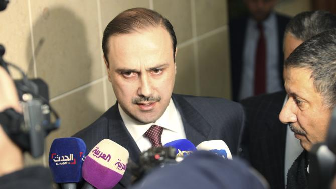 Jordan's Information Minister al-Momani speaks to the media after a closed door meeting of the parliamentary government in the House of Representatives in Amman