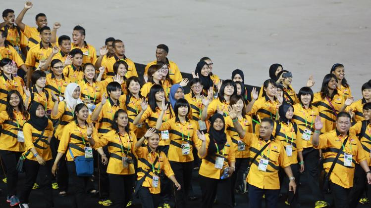 Malaysian athletes take part in a parade during the opening ceremony of the 27th SEA Games in Naypyitaw
