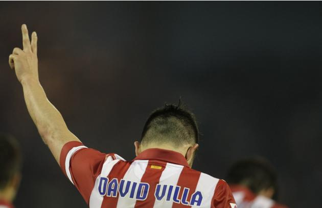 Atletico Madrid's Villa celebrates his second goal against Celta Vigo during their Spanish first division soccer match at the Balaidos stadium in Vigo
