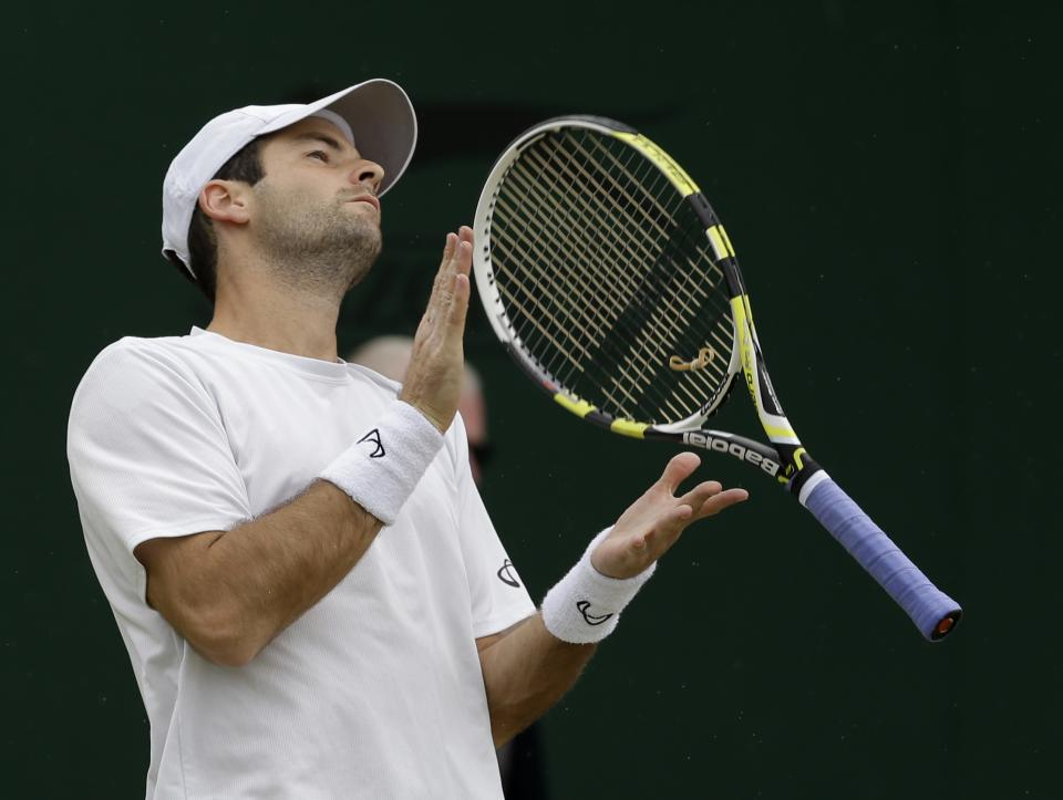 Brian Baker of the United States reacts during a fourth round singles match against Philipp Kohlschreiber of Germany at the All England Lawn Tennis Championships at Wimbledon, England, Tuesday, July 3, 2012. (AP Photo/Alastair Grant)
