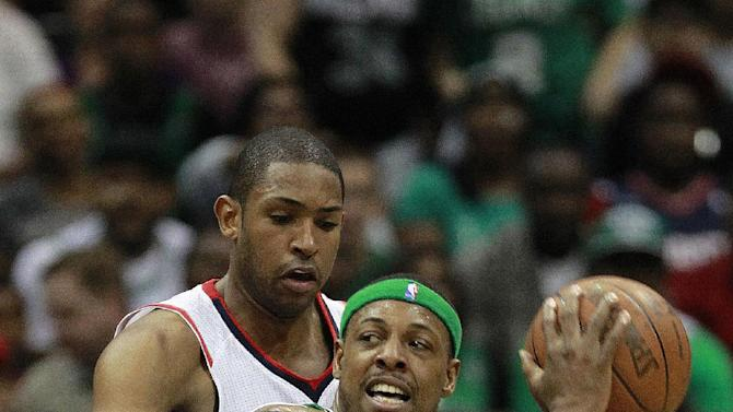 Boston Celtics small forward Paul Pierce (34) is covered by Atlanta Hawks center Al Horford (15) and Jeff Teague (0) during the first half of Game 5 of an NBA first-round playoff series basketball game Tuesday, May 8, 2012, in Atlanta. (AP Photo/John Bazemore)