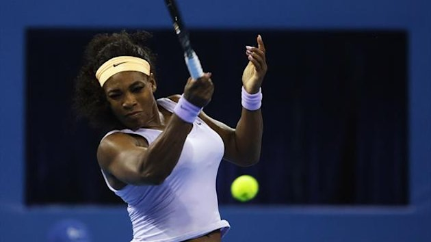 Serena Williams of the US returns a shot against Caroline Wozniacki of Denmark during the quarterfinal match in the China Open tennis tournament at the National Tennis Stadium, in Beijing October 4, 2013 (Reuters)