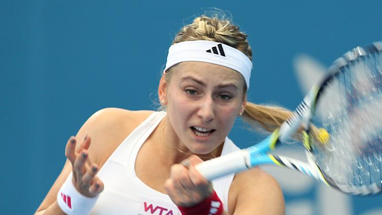 Ksenia Pervak of Kazakhstan plays a shot during her quarter final match against Victoria Azarenka of Belarus during the Brisbane International tennis tournament in Brisbane, Australia, Thursday, Jan 3, 2013.  (AP Photo/Tertius Pickard)