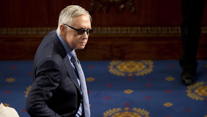 """FILE  In this March 25, 2015 file photo, Senate Minority Leader Harry Reid of Nev. waits on the floor of the House Capitol Hill in Washington for the arrival of Afghanistan's President Ashraf Ghani, who was to speak before  a joint meeting of Congress. Reid is announcing he will not seek re-election to another term. The 75-year-old Reid says in a statement issued by his office Friday that he wants to make sure Democrats regain control of the Senate next year and that it would be """"inappropriate"""" for him to soak up campaign resources when he could be focusing on putting the Democrats back in power. (AP Photo/Pablo Martinez Monsivais, File)"""