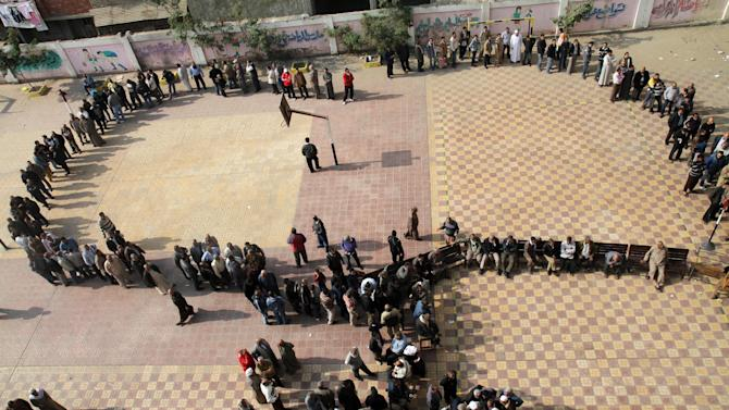 FILE - In this Saturday, Dec. 15, 2012 file photo, Egyptians wait in line to cast their votes during a referendum on a disputed constitution drafted by Islamist supporters of President Morsi in Cairo, Egypt. Barely a third of voters turned out for the referendum on a constitution meant to be a historic milestone in setting Egypt's future. Perhaps it was fatigue after multiple elections, or a frustrated shrug. (AP Photo/Ahmed Gomaa, File)