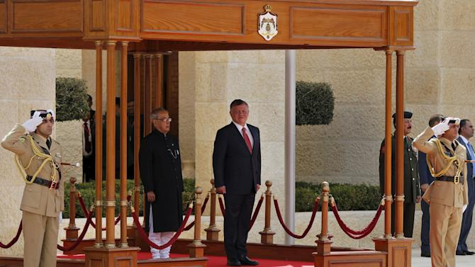 Abdullah and Mukherjee review an honour guard before their meeting at the Royal Palace in Amman