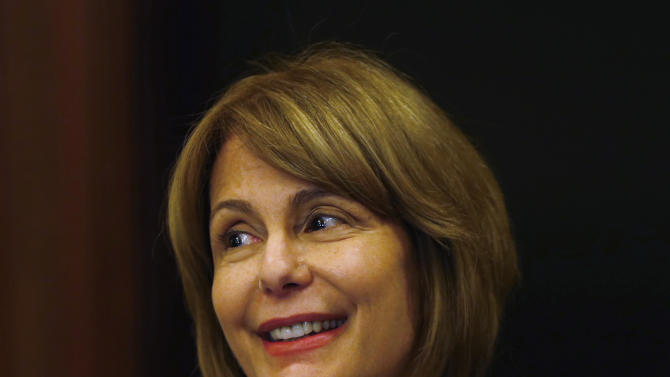 New Jersey State Sen. Barbara Buono, the likely Democratic nominee for governor, responds to New Jersey Gov. Chris Christie's 2014 state budget in Trenton, N.J., Tuesday, Feb. 26, 2013. Christie delivered his fourth budget proposal before a joint session of the Legislature at the State House during an election year as the state rebounds from the worst natural disaster in its history. (AP Photo/Rich Schultz)