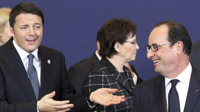Italy's Prime Minister Renzi and France's President Hollande pose during photo family at a European Union leaders summit in Brussels