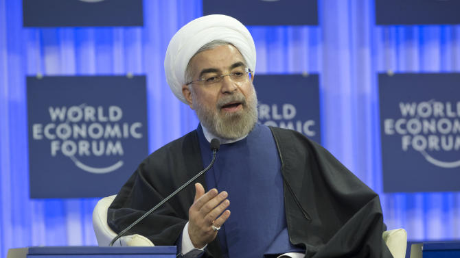Iranian President Hassan Rouhani, gestures as speaks during a session of the World Economic Forum in Davos, Switzerland, Thursday, Jan. 23, 2014. Leaders gathered in the Swiss ski resort of Davos have made it a top priority to push to reshape the global economy and cut global warming by shifting to cleaner energy sources. (AP Photo/Michel Euler)