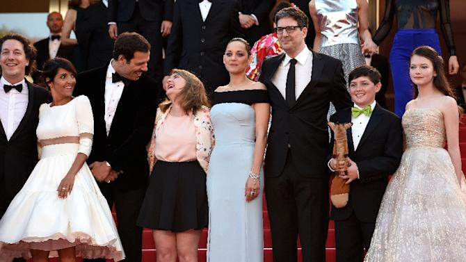 """Guillaume Gallienne (L), Florence Foresti, Laurent Lafitte, Clara Poincare, Marion Cotillard, Mark Osborne, Riley Osborne, Mackenzie Foy at the screening of """"The Little Prince"""" at the 68th Cannes Film Festival in Cannes, France, on May 22, 2015"""