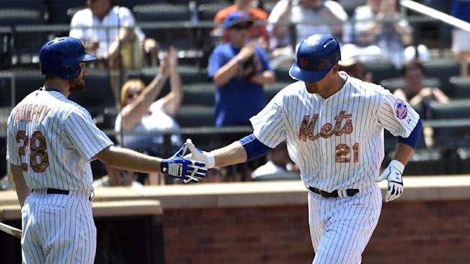 New York Mets' Daniel Murphy (28) greets  Lucas Duda (21) at home plate after Duda hit a solo home run off of Philadelphia Phillies starting pitcher Severino Gonzalez in the third inning of a baseball game at Citi Field on Monday, May 25, 2015, in New York. (AP Photo/Kathy Kmonicek)