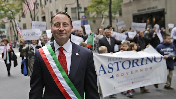 Republican gubernatorial candidate Rob Astorino marches in the Columbus Day parade in New York, Monday, Oct. 13, 2014. The debate Wednesday Oct. 22, 2014 between Gov. Andrew Cuomo, Republican Rob Astorino and two third-party candidates probably will be the only chance voters get to see the candidates for New York governor spar before the election. The election is Nov. 4. (AP Photo/Seth Wenig)