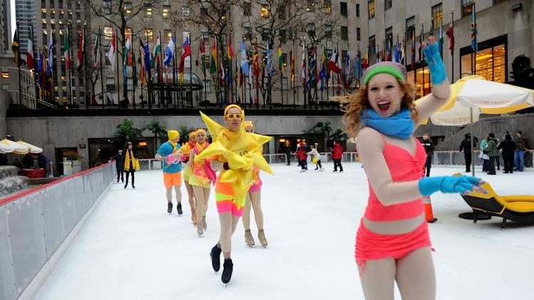 IMAGE DISTRIBUTED FOR GREATER FORT LAUDERDALE - Swimsuit clad ice skaters take to The Rink at Rockefeller Center as Greater Fort Lauderdale Convention & Visitors Bureau (CVB) transforms it into a tropical island paradise for the launch of CVB's new Hello Sunny campaign, Wednesday, Jan. 16, 2013, in New York.  CVB's new promotion encourages New Yorkers and the nation to enjoy the warm Greater Fort Lauderdale sunshine. Visit www.sunny.org/defrost for a chance to win a Fort Lauderdale beach getaway. (Photo by Diane Bondareff/Invision for Greater Fort Lauderdale/AP Images)