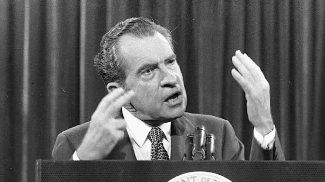 FILE - This Nov. 17, 1973 black-and-white file photo shows President Richard Nixon uses his hands while answering questions put to him by members of the Associated Press Managing Editors at Disney World near Orlando, Fla. Second presidential terms are never easy. More often, they're fraught with peril, frequently marred by scandal, failure, hubris, and burnout and souring relations with Congress. (AP Photo, File)