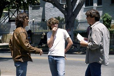 Billy Crudup and Patrick Fugit go over a scene with writer/director/producer Cameron Crowe on the set of Dreamworks' Almost Famous