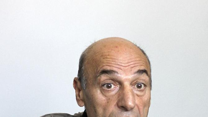 "This June 26, 2012 photo shows Sumbat Tonoyan at a prison in Rustavi, Georgia. The dairy farmer who went bankrupt was one of two smugglers arrested with highly enriched uranium in 2010. They had obtained the material from Armenian Garik Dadaian and were offering it as a sample of a larger quantity. In separate interviews, each man blamed the other for the idea of smuggling uranium, and talked of financial hardship. Tonoyan said a bank had seized his house after his dairy factory collapsed. ""I didn't have a job and I couldn't pay the bank,"" he said in Russian through an interpreter. (AP Photo)"