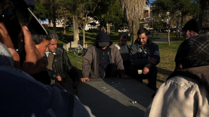 In this Monday, Jan. 28, 2013 photo, a group of Hispanics play a dice game at a park in Los Angeles. Seeking swift action on immigration, President Barack Obama on Tuesday will try to rally public support behind his proposals for giving millions of illegal immigrants a pathway to citizenship, as well as making improvements to the legal immigration system and border security. (AP Photo/Jae C. Hong)