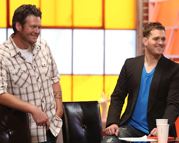 "Blake Shelton, left, and Michael Buble on the set of NBC's ""The Voice,"" on Monday, July 9, 2012, in Los Angeles. Michael Buble will act as adviser to Blake Shelton's team of contestants on ""The Voice,"" returning for its new season in September. (AP Photo/NBC, Tyler Golden)"