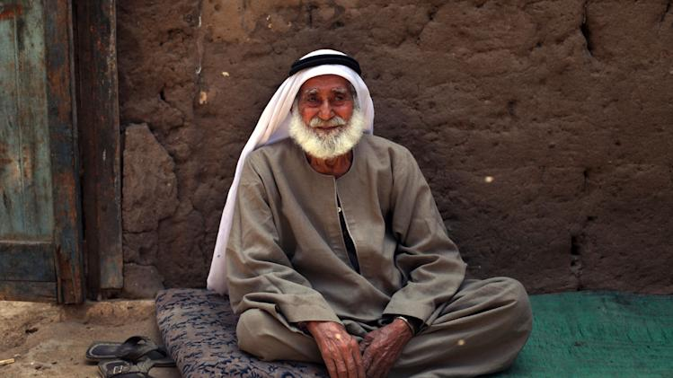 In this Friday, May 17, 2013 photo, Palestinian refugee Sulaiman al-Namodi, 92, sits outside of his house in Gezirat al-Fadel village, Sharqiya, about 150 kilometers (93 miles) east of Cairo, Egypt. As Palestinians around the world recently marked the 65th anniversary of their mass displacement during the war over Israel's 1948 creation, the refugees in Gezirat al-Fadel say they have it worse than others who fled to Jordan, Syria or Lebanon. Unlike the millions who live in refugee camps in those countries, the United Nations Relief and Works Agency (UNRWA) does not have offices in Egypt and so does not offer Palestinians in Gezirat al-Fadel assistance. (AP Photo/Khalil Hamra)