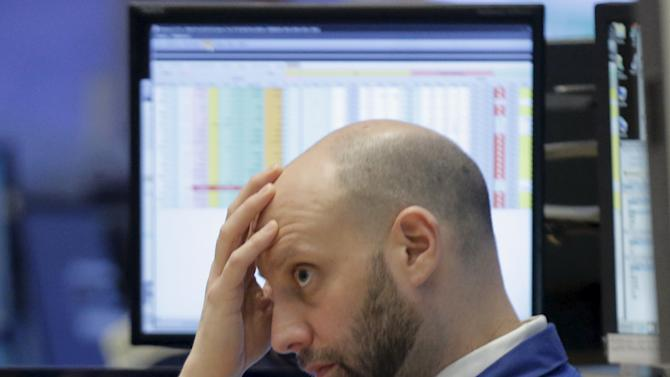 A specialst trader works at a booth on the floor of the NYSE