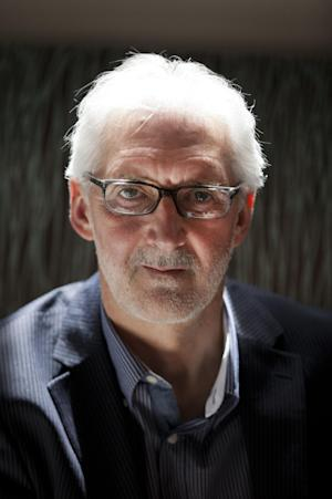 """British Cycling president Brian Cookson poses for photographs during a media briefing session in London, Tuesday, June 4, 2013. Cookson will challenge Pat McQuaid for the presidency of the International Cycling Union in a bid to restore the sport's reputation. Cookson, who had previously backed McQuaid's re-election bid, said in a statement provided by British Cycling that the """"widespread absence of confidence in the integrity of the organization"""" led him to challenge the incumbent. (AP Photo/Matt Dunham)"""
