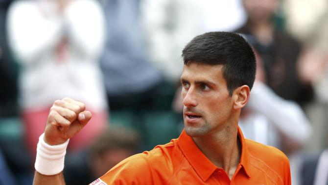 Novak Djokovic of Serbia celebrates after beating Gilles Muller of Luxembourg during their men's singles match at the French Open tennis tournament at the Roland Garros stadium in Paris