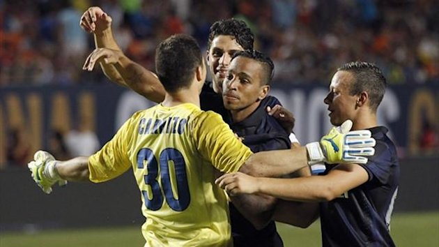 Inter Milan's goalkeeper Juan Pablo Carrizo (L), who scored the winning goal in their penalty-shoot out against Juventus, celebrates with his team-mates in their Guinness International Champions Cup match in Miami (Reuters)