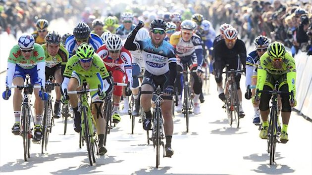 British Mark Cavendish of team Omega Pharma - Quick Step (C) celebrates as he crosses the finish line to win the second stage of the Driedaagse De Panne - Koksijde cycling race (AFP)