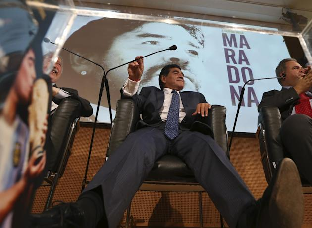 Former Argentine's soccer star Diego Armando Maradona smiles during a press conference in Milan, Italy, Thursday, Oct. 17, 2013. Diego Maradona said he would like to coach his former club Napoli. The