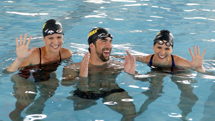 Olympic swimming champion Michael Phelps joins his sisters Whitney, left, and Hilary in the pool for a cross training swim as Whitney prepares to run the ING New York City Marathon with Team SUBWAY at the Chelsea Piers Sport Center, Monday, Oct. 15, 2012 in New York. (Photo by Jason DeCrow/Invision for SUBWAY/AP Images)