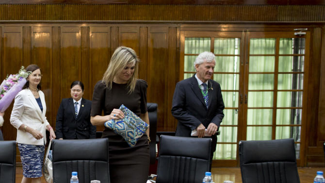 Queen Maxima of the Netherlands arrives at the University of Yangon, Tuesday, March 31, 2015, ahead of her speech on the importance of access to financial services, Yangon, Myanmar. Queen Maxima began a three day visit to Myanmar on Monday as the UN Secretary-General's Special Advocate for Inclusive Finance for Development. (AP Photo/Gemunu Amarasinghe)