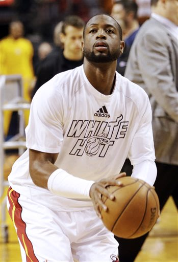 Miami Heat guard Dwyane Wade (3) warms up before Game 1 of the NBA basketball Eastern Conference finals playoff series against the Indiana Pacers, Wednesday, May 22, 2013 in Miami