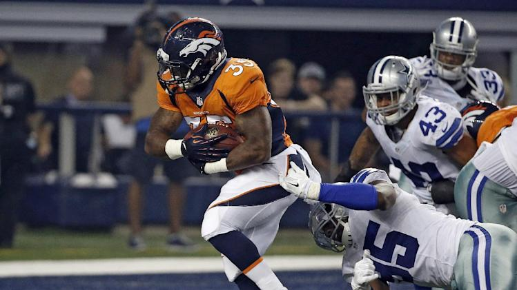 Denver Broncos running back Kapri Bibbs (35) fights his way past Dallas Cowboys defensive end Caesar Rayford (95) into the end zone for a touchdown in the second half of a NFL preseason football game, Thursday, Aug. 28. 2014, in Arlington, Texas