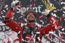 Kurt Busch celebrates after winning the NASCAR Sprint Cup auto race at Richmond International Raceway in Richmond, Va., Sunday, April 26, 2015. (AP Photo/Steve Helber)