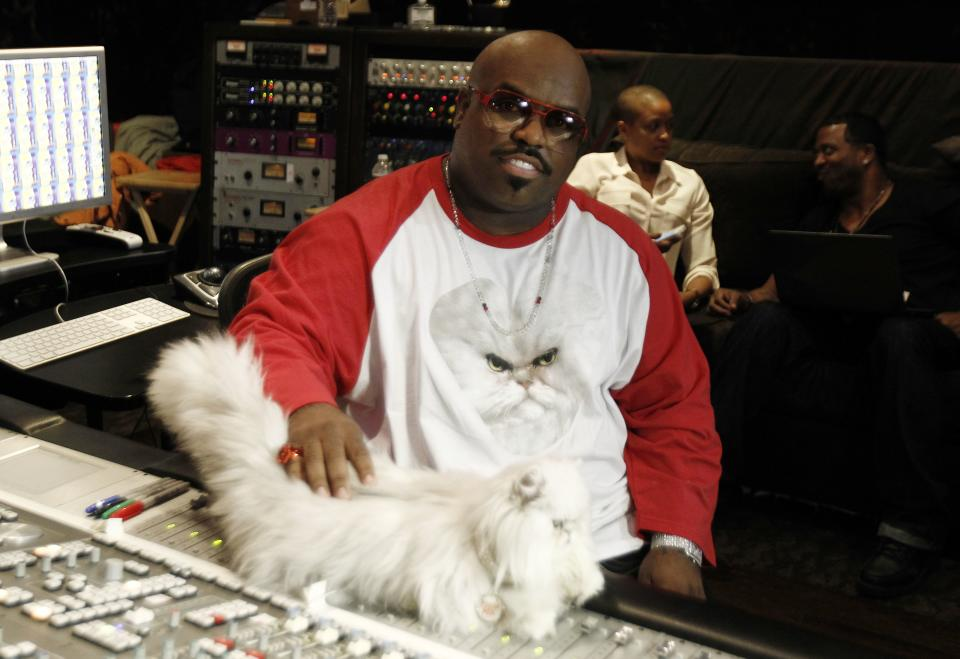 "In this May 2, 2012 photo, musician Cee-Lo Green and Purrfect the cat pose for a photo while working on the remix of the Meow Mix jingle in Los Angeles. Green, a judge on the singing competition series ""The Voice,"" says he'll stick with the show ""as long as it's fresh."" The rapper turned singer joined the show last year as coach and judge alongside Christina Aguilera, Blake Shelton and Adam Levine. (AP Photo/Matt Sayles)"