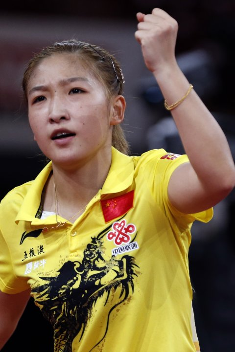 Liu Shiwen of China reacts after defeating compatriot Zhu Yuling in their women's singles semifinals match at the World Team Table Tennis Championships in Paris
