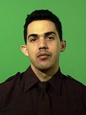 ADDS KELLY'S TITLE - This image provided by the New York City Police Department shows officer Juan Pichardo who was working off-duty at his family's car dealership, Thursday Jan. 3, 2013 when two men, one armed with a handgun, entered the dealership while two other men waited outside in a getaway car, New York Police Commisioner Kelly said. Pichardo was shot in the right thigh while disarming the suspect. (AP Photo/New York City Police Department)