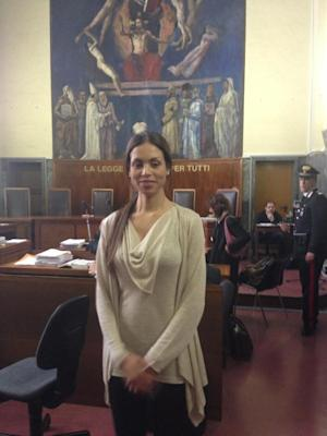 """Karima el Mahroug stands in a court in Milan, Italy, Friday, May 24, 2013. The woman at the center of ex-Premier Silvio Berlusconi's sex scandal has denied in court ever telling a former roommate that she had sex with the then-premier. Karima el Mahroug appeared for a second day of testimony Friday at the trial of three former Berlusconi aides charged with procuring prosecutors for the media mogul's infamous """"bunga bunga"""" parties. The trial is separate from the one charging Berlusconi with having paid for sex with a minor, el Mahroug herself, and then trying to cover it up. (AP Photo/Giuseppe Aresu)"""