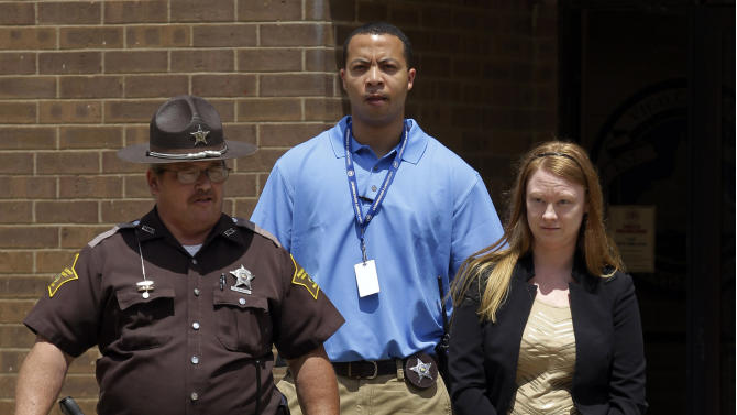 Stephanie Foster is escorted to the Vigo County Courthouse for a sentencing hearing in Terre Haute, Ind., Friday, July 13, 2012. The 36-year-old Terre Haute woman pleaded guilty May 14 to a felony charge of armed robbery resulting in serious bodily injury in the June 2010 attack during which she stabbed a couple while trying to kidnap their month-old son, in what authorities said was a plot to pass off the baby as her own. (AP Photo/Michael Conroy)