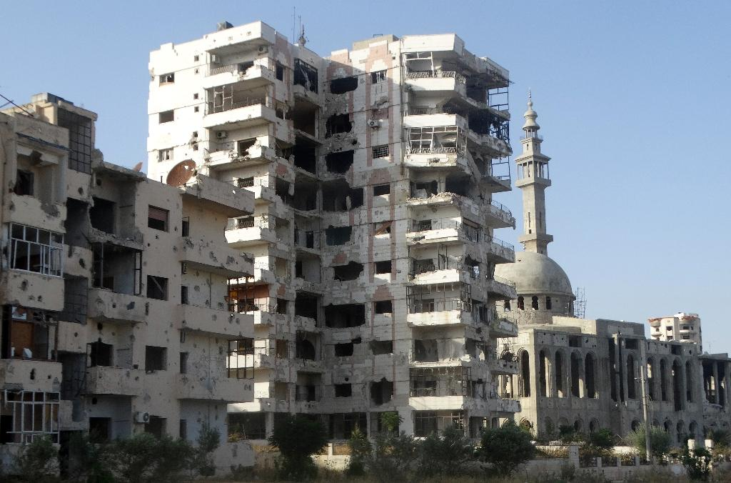 Negotiations seek Syria rebel exit from Homs: governor