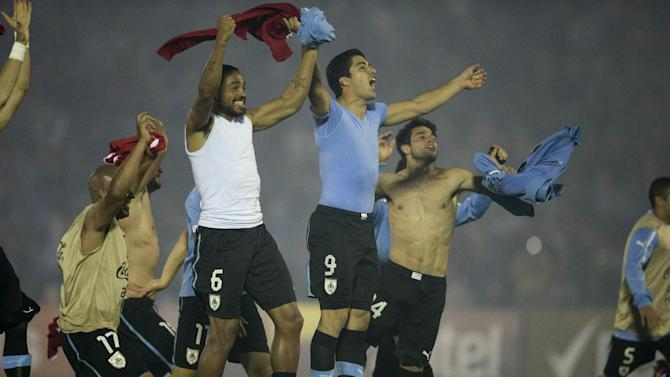 Uruguay's players celebrate after qualifying for the 2014 World Cup after playing a qualifying playoff second leg soccer match with Jordan in Montevideo, Uruguay, Wednesday, Nov. 20, 2013. The match ended 0-0