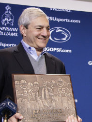 "FILE - In this Oct. 29, 2011 file photo, Penn State President Graham Spanier presents head football coach Joe Paterno with a plague commemorating his 409th collegiate win after an NCAA college football game against Illinois in State College, Pa. Spanier is accused of perjury, endangering children and other charges in the Jerry Sandusky molestation scandal. According to online court records charges were filed, Thursday, Nov. 1, 2012, against Penn State's ex-president and two other administrators in what prosecutors called ""a conspiracy of silence."" (AP Photo/Gene J. Puskar)"