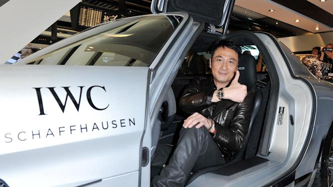 IMAGE DISTRIBUTED FOR IWC SCHAFFHAUSEN  -  Francis Ng  visits the IWC booth during the Salon International de la Haute Horlogerie (SIHH) 2013 at Palexpo in Geneva, Switzerland on Jan. 22, 2013. (Image Gate/Photopress for IWC via AP Images)