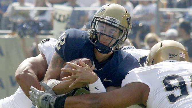 Pittsburgh quarterback Tino Sunseri, center, is sacked by Notre Dame defensive end Ethan Johnson, right, and linebacker Manti Te'o in the first quarter of an NCAA football game, Saturday, Sept. 24, 2011 in Pittsburgh. (AP Photo/Keith Srakocic)