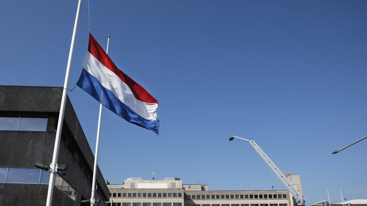 The national flag of the Netherlands is flown at half staff at the town hall in Eindhoven