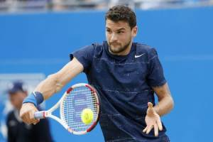 Bulgaria's Dimitrov returns the ball to Spain's Lopez during their men's singles final tennis match at the Queen's Club Championships in west London