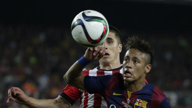 Athletic Bilbao's Unai Bustinza, left and Barcelona's Neymar fight for the ball with during the final of the Copa del Rey soccer match between FC Barcelona and Athletic Bilbao at the Camp Nou stadium in Barcelona, Spain, Saturday, May 30, 2015. (AP Photo/Emilio Morenatti)