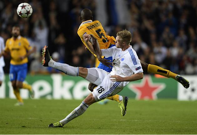 Juventus' Angelo Ogbonna and FC Copenhagen's Nicolai Jorgensen, foreground,  vie for the ball,  during their Champions League Group B soccer match at Parken Stadium, Copenhagen, Denmark, Tuesday Sept.